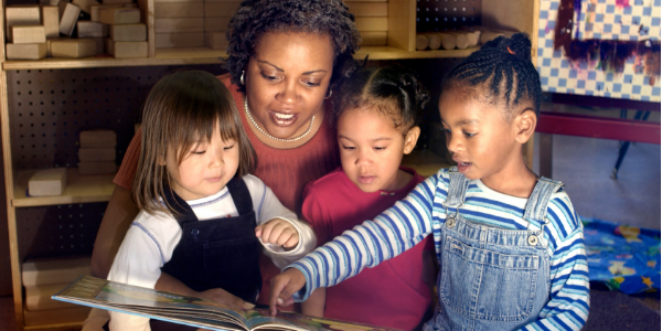 Three Children Reading with an Adult