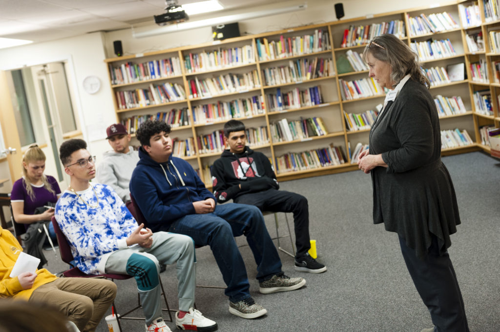 Woman Talking to High School Students