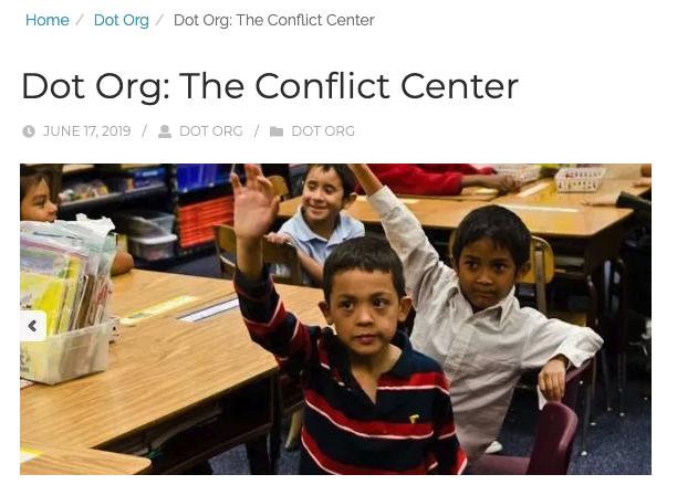 Children Raising their Hands in School