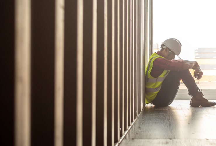 Construction Worker Sitting Down
